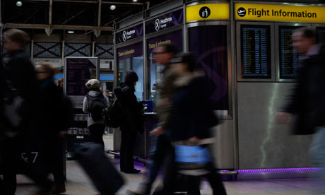 Travellers buy tickets for the Heathrow Airport Express train at Paddington train station