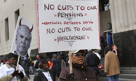 Protesters demonstrate against cuts to Detroit city workers' pensions and healthcare