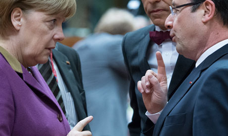 German Chancellor Angela Merkel chatting with French President Francois Hollande