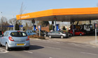 Drivers queue for petrol and diesel at a Sainsbury&#39;s supermarket filling station in Harrogate