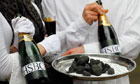 World Development Movement campaigners set up a Carbon Bubbles champagne bar outside HSBC's AGM
