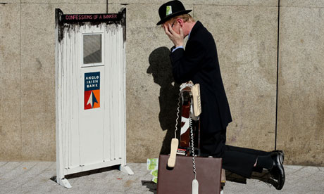 Performance artist Frank O'Dea with his installation piece 'Confessions of a Banker' in Dublin