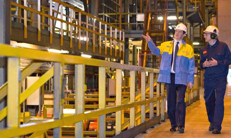 George Osborne speaks with with works manager Richard O'Neil (R) on a visit to Tata Steel in Wales