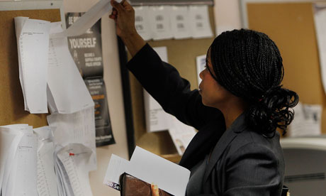 A US job-seeker looks over listings on a board at a New York State Employment Services office