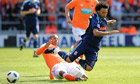Blackpool's DJ Campbell fouls Stoke City's Jermaine Pennant, right.