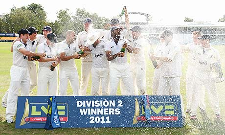 Middlesex celebrate winning the Division Two of the County Championship after beating Leicestershire