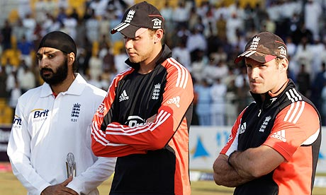 England's Andrew Strauss, Stuart Broad and Monty Panesar after defeat to Pakistan