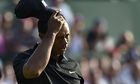 Tiger Woods tips his cap after finishi