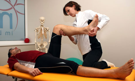 Physio bending guys leg