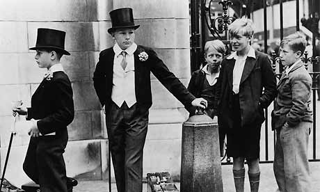 eton college uniform. Eton boys in top hats, London,