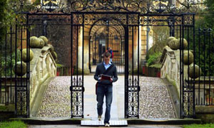 A student outside Clare College, Ca