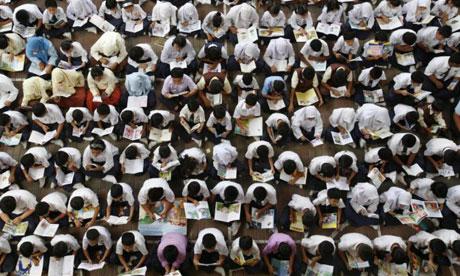 Malaysian children reading in the 'Read 2008' read-a-thon at a school in Putrajaya outside Kuala Lumpur. Photograph: Bazuki Muhammad/Reuters