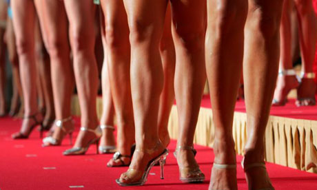 Women line the stage during a Miss International beauty pageant press preview in Tokyo. Photograph: Issei Kato/Reuters