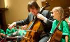 In Harmony: Julian Lloyd Webber and a young musician of West Everton children's orchestra