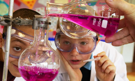 Two schoolboys watching an experiment
