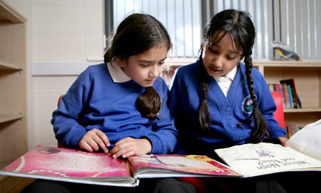 Aisha Khan, eight, and Ibra Ahmed, nine, engaging in activities at Thornbury school in Bradford