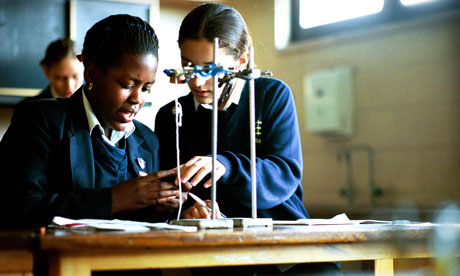 Pupils conducting an experiment during a science lesson at Salisbury Secondary School, Enfield