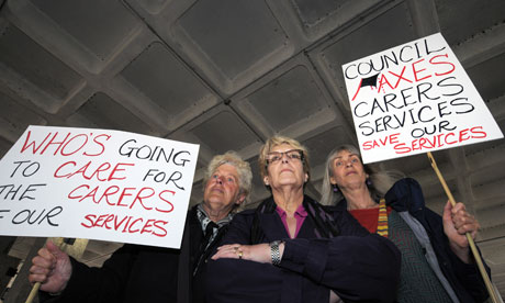 Carers protest outside Hammersmith town hall, London, about the closure of a carer centre