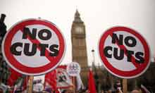 A march in protest at government cuts passes parliament in London on its way to Hyde Park