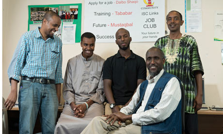 At the Islington Somali Community centre, tutor Abdullahi Awale sits with co-workers