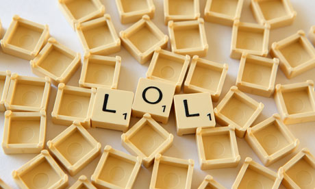 Scrabble tiles spell out LOL
