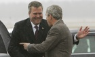 Former US president George W Bush is greeted by his brother Jeb, who was at Gove's side