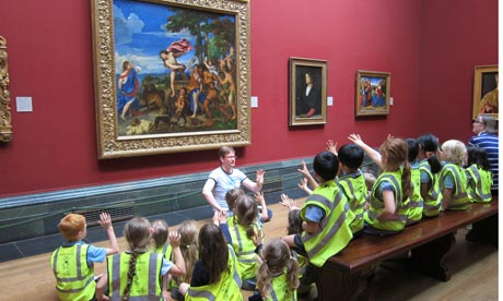 Children studying a painting in the National Gallery