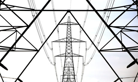 Climate Change And Global Pollution: A line of electricity pylons crosses the Essex countryside