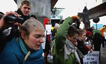 COP15 A German climate activist cries as her hair is cut 