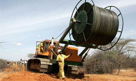 MDG: Broadband in Africa : A team of engineers lay fibre optic cables , Kenya