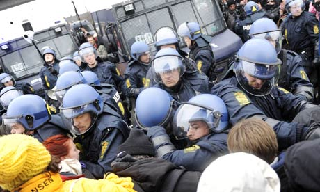 Police forces push back activists during a protest in Copenhagen on 16 December 2009 on the 10th day of the COP15 UN Climate Change Conference. Photograph: Adrian Dennis/AFP/Getty Images