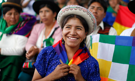 Cancun COP16 : A Bolivian woman smiles as she takes part in a forum, MDG