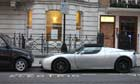 The Tesla Roadster electric car sits at one of Westminster's juice point