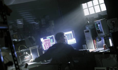 hacker surrounded by computers