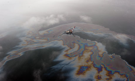 leaked oil floating off the coast of Dalian, northeast China's Liaoning province