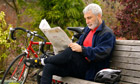 Helen Blog bike : Bearded cyclist reading newspaper in a park
