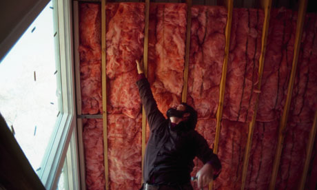 Green deal : Installing Fiberglass Insulation