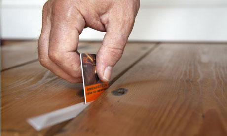 Insulating and draughtproof floorboards