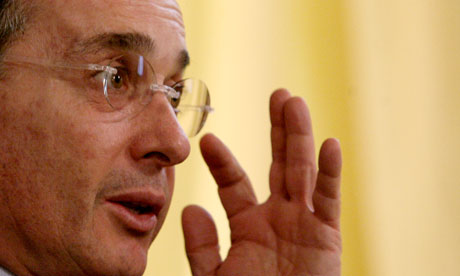 MDG : Former Colombian President Uribe answers a question during an interview