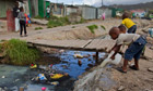 MDG : Water special : sanitation :  heavily polluted stream running in urban area, South Africa