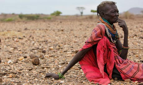 MDG : Horn Of Africa famine : An ethnic Turkana woman sits on the ground in Turkana, Kenya