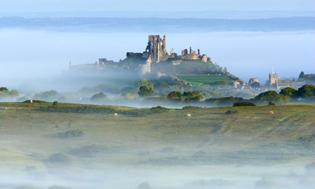 Country Diary : Corfe Castle surrounded by early morning mist on the Isle of Purbeck, Dorset