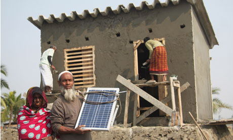 MDG : disaster resistant homes and solar panel as part of a Dfid pilot project in Bangladesh
