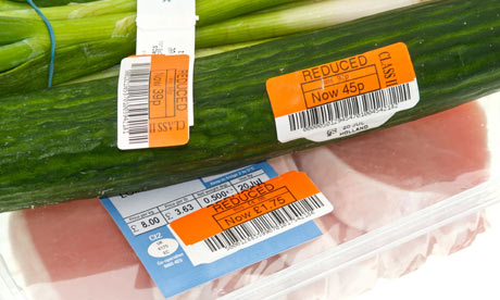 Reduced price labels on food items in supermarket