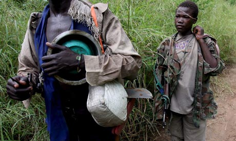 MDG : A boy soldier from the Lord's Resistance Army on his way to an LRA camp set up in Owinykibul