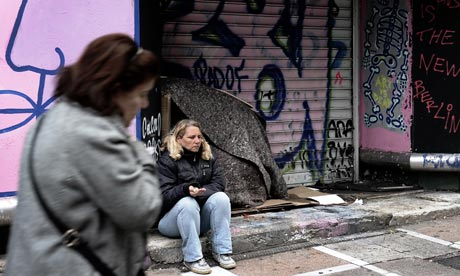 MDG : EU crisis : A woman begs for money in central in Athens , Greece