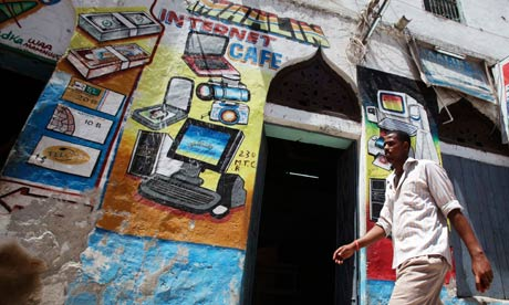 MDG : Somalia : A man walks past an Internet cafe in Hamarweyne district of capital Mogadishu