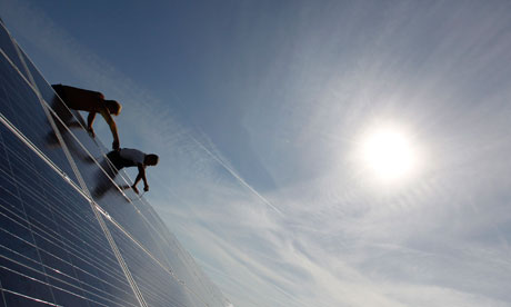 Damian in Germany : Solar : construction workers fixing solar panels