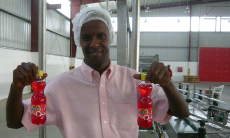 MDG : Mark in Somaliland : Moustapha Guelleh holds strawberry Fanta at Coka Cola plant