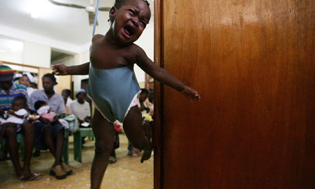 MDG : Child mortality and maternal health :  Haiti, baby is weighed at a clinic